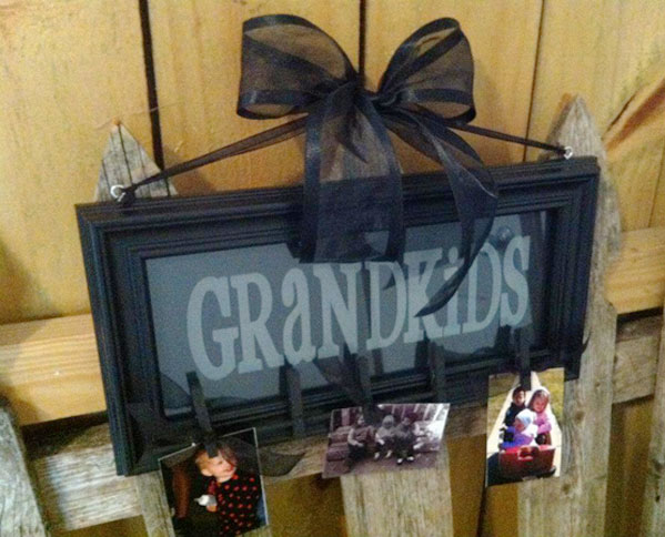 engraved sign with picture hooks